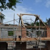 Oak Trusses going up,July 2015, design & manufacture by Interesting Timbers