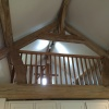 Finished Fitting Safety Rail In Oak Roof Truss, Loft Room